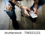 hand holding mobile phone...   Shutterstock . vector #708321121