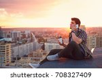 a hipster man drinks coffee and ...   Shutterstock . vector #708327409