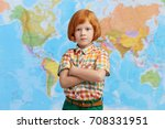 seious small male boy with... | Shutterstock . vector #708331951