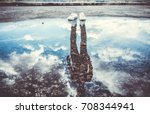 reflection of man standing near ... | Shutterstock . vector #708344941