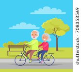 happy mature couple riding... | Shutterstock .eps vector #708353569
