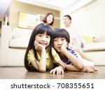 asian brother and sister lying... | Shutterstock . vector #708355651