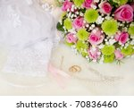 Wedding bouquet and rings, soft focus. - stock photo