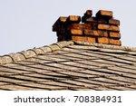 broken red chimney on the old... | Shutterstock . vector #708384931