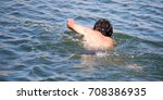 the man is swimming in the lake   Shutterstock . vector #708386935