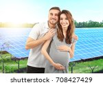 young man with pregnant wife... | Shutterstock . vector #708427429