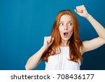 Exuberant Young Woman Cheering...