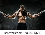 muscular man with rope. photo... | Shutterstock . vector #708464371