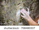 rock climber's hand gripping...   Shutterstock . vector #708480337