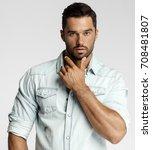 portrait of handsome male model | Shutterstock . vector #708481807