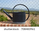 water can sitting on brick ledge | Shutterstock . vector #708483961