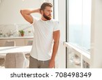 cool bearded man posing near... | Shutterstock . vector #708498349