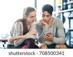 fit couple in modern crossfit... | Shutterstock . vector #708500341