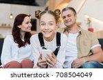 mature parents and teen girl... | Shutterstock . vector #708504049