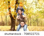 family playing in autumn park... | Shutterstock . vector #708522721