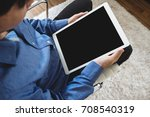 a man using digital tablet... | Shutterstock . vector #708540319