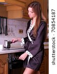 Beautiful young woman make coffee at the home kitchen - stock photo