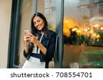indian woman texting on her...   Shutterstock . vector #708554701