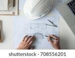 architect working on blueprint  ... | Shutterstock . vector #708556201