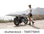 young woman biker with custom... | Shutterstock . vector #708575845