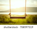 children swing in the park ... | Shutterstock . vector #708597319