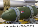 Small photo of A warhead on a transport stand, against a rocket. Weapons of mass destruction. Nuclear weapons, chemical weapons, a bomb.
