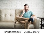 young man talking on the phone... | Shutterstock . vector #708621079