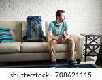 young adult with a backpack... | Shutterstock . vector #708621115