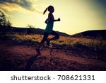 trail runner woman running on... | Shutterstock . vector #708621331