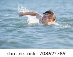 Teenage boy in the sea on a summer's day - stock photo