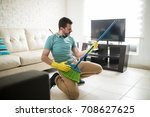 playful man in the living room... | Shutterstock . vector #708627625
