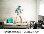 modern man listening to music... | Shutterstock . vector #708627724