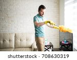 single man dusting his... | Shutterstock . vector #708630319