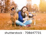 girl with dogs in the park.... | Shutterstock . vector #708647731