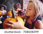 Kids Preparing A Pumpkins For...