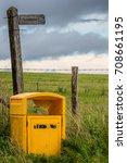 Sign Post And Rubbish Bin On...