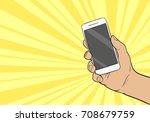 hand holding mobile phone.... | Shutterstock .eps vector #708679759
