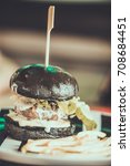 charcoal beef burger with...   Shutterstock . vector #708684451