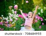 happy little girl jumps on a... | Shutterstock . vector #708684955