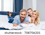 happy family smiling at camera... | Shutterstock . vector #708706201