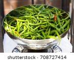 long spicy green pepper in... | Shutterstock . vector #708727414