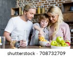 happy young family eating corn... | Shutterstock . vector #708732709