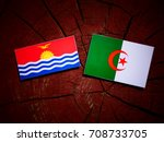 Small photo of Kiribati flag with Algerian flag on a tree stump isolated
