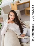 lost in her novel. beautiful...   Shutterstock . vector #708752365