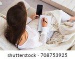 attractive brunette woman write ...   Shutterstock . vector #708753925