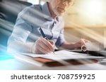 senior businessman taking notes ... | Shutterstock . vector #708759925