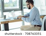 young bearded man working on... | Shutterstock . vector #708763351