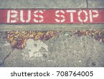 old bus stop sign on a sidewalk ... | Shutterstock . vector #708764005