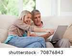 couple looking at their laptop... | Shutterstock . vector #70876843