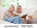 couple looking at their photo... | Shutterstock . vector #70877893